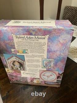 1991 Enesco Precious Moments Toyland Illuminated Musical Action Clock