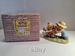 Lot of 12 Precious Moments Country Lane figures withoriginal boxes