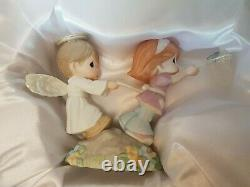 Precious Moments Chapel Exclusive Figurine Held by the Hands of Faith